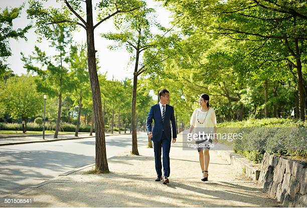 business people walking in the park - striped suit stock pictures, royalty-free photos & images