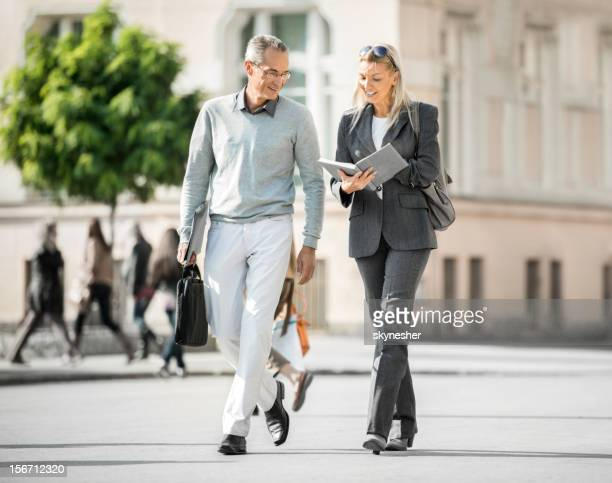 Business people walking in the streets.