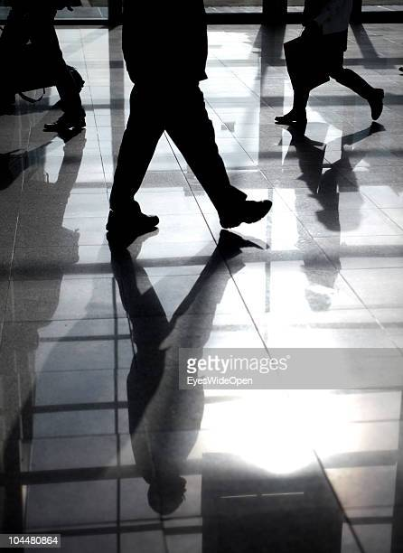 Business people walking on an escalator at the Photokina fair on September 21 2010 in Cologne Germany The Photokina is the world's biggest trade fair...