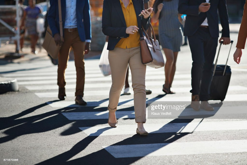 Business people walking on pedestrian crossing : Stock Photo