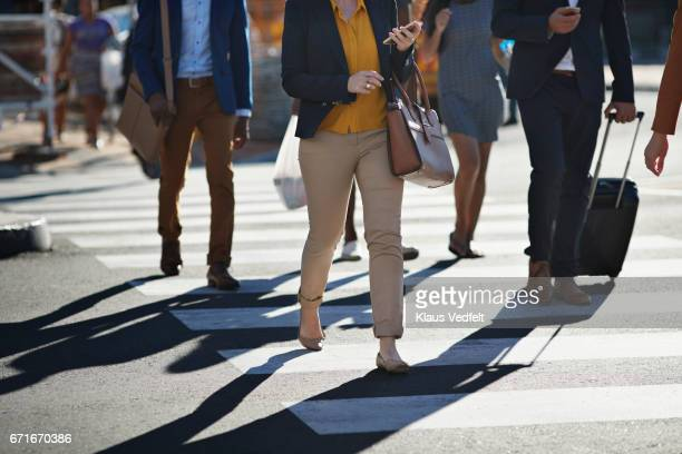 business people walking on pedestrian crossing - pedestrian crossing stock photos and pictures
