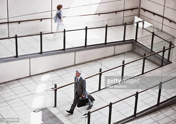 Business people walking on ramp