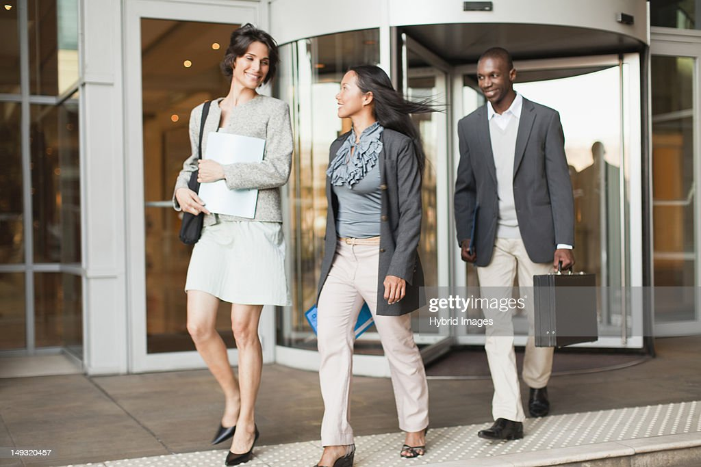 Business people walking on steps : Stock Photo