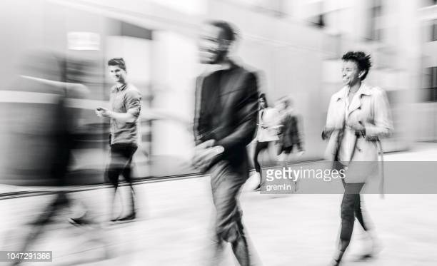 business people walking on the street - black and white stock pictures, royalty-free photos & images
