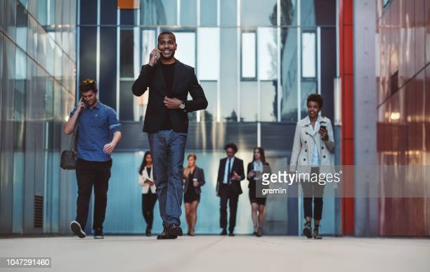 business people walking on the street - business community stock pictures, royalty-free photos & images