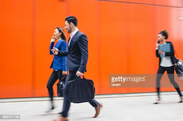 Business People Walking Outside Building, Blurred motion