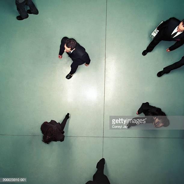 Business people walking, overhead view