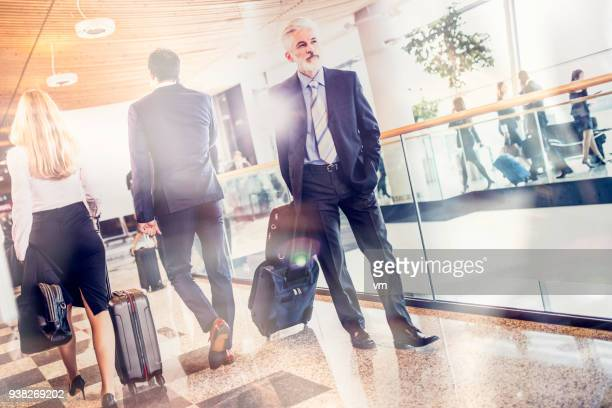 Business people walking through an airport terminal