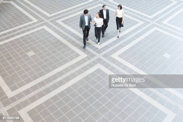 Business people walking through Japanese office foyer, overhead view
