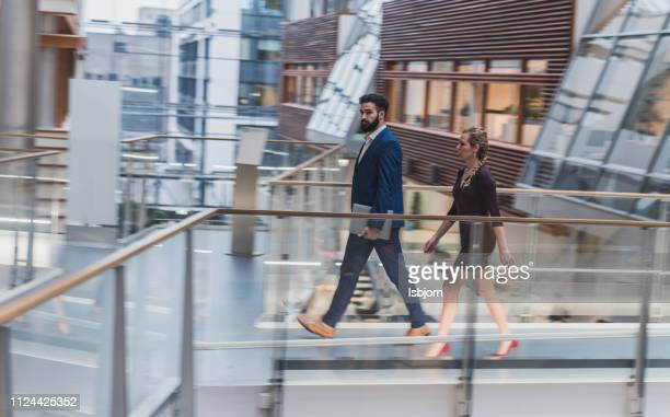 business people walking to the office. - business finance and industry stock pictures, royalty-free photos & images