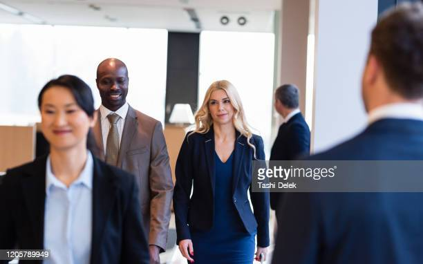 business people walking to the office - ambassador stock pictures, royalty-free photos & images
