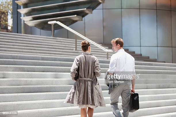 Business people walking toward steps outdoors