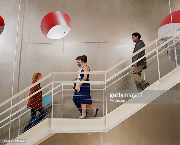 Business people walking up and down on stairs