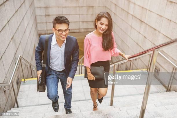 Business people walking up stairway in downtown Kuala Lumpur