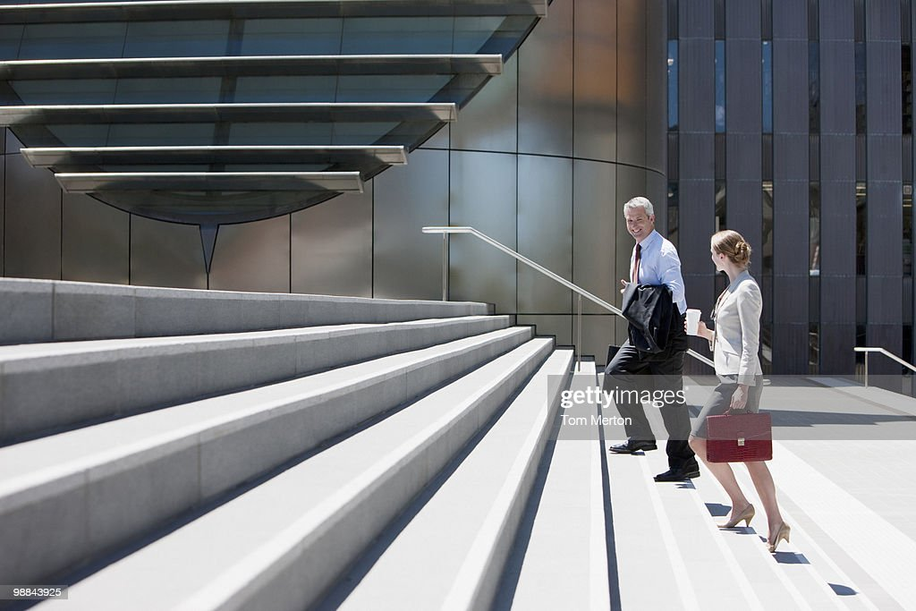Business people walking up steps : Stock Photo