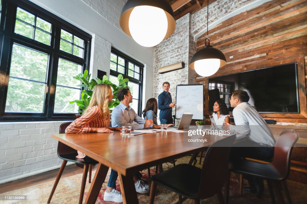 Business people watching a presentation on the whiteboard : Foto de stock