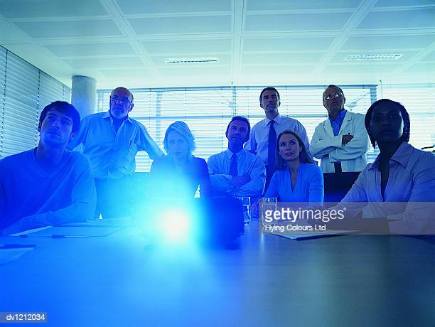 Business People Watching a Projection Presentation