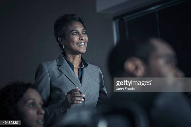 business people watching audio visual presentation in meeting - focus on background stock pictures, royalty-free photos & images