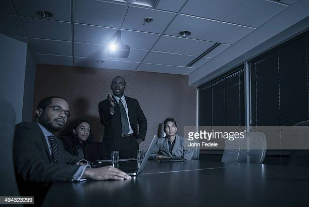 Business people watching presentation in meeting