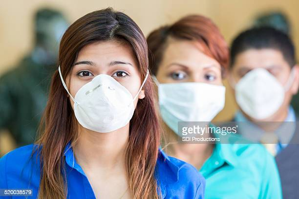 business people wearing medical masks during flu or contagious pandemic - pandemic illness stock pictures, royalty-free photos & images