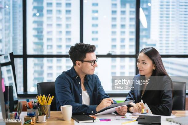 business people with a team talking in office - work romance stock pictures, royalty-free photos & images
