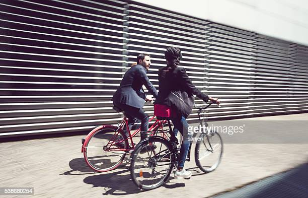 Business people with bike on the street
