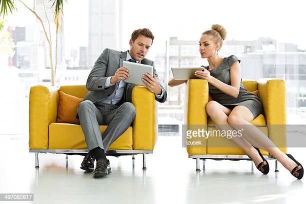 Business people with digital tablets