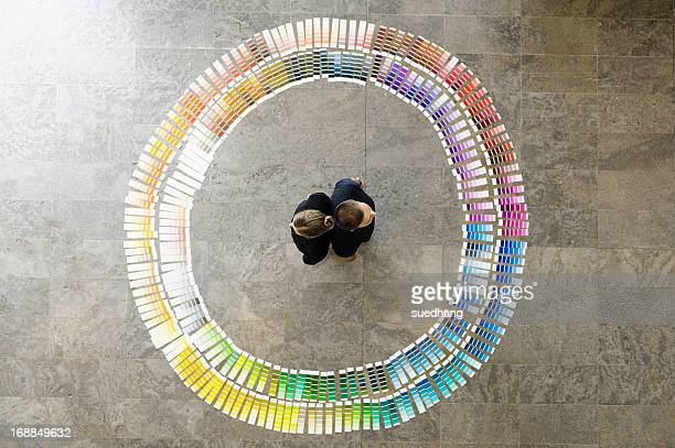 Business people with paint swatches