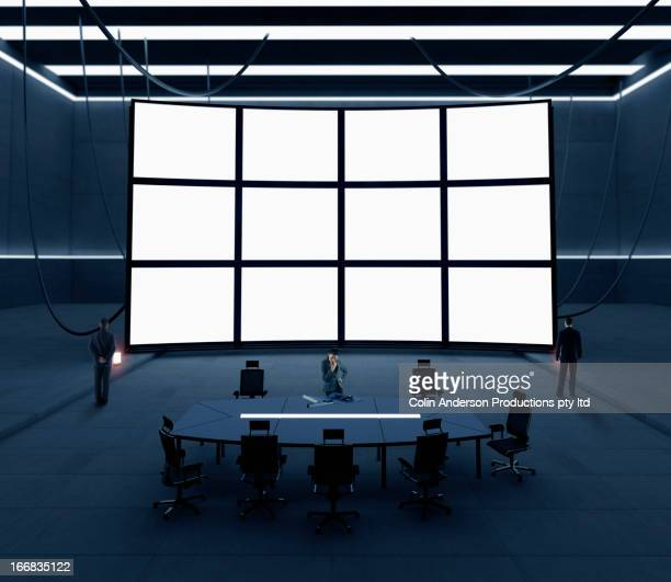 Business people with screens in conference room