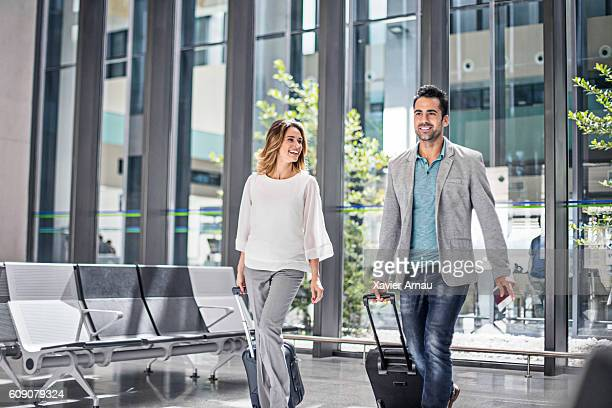 Business people with suitcases in airport