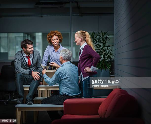 Business people with wine bottles in office