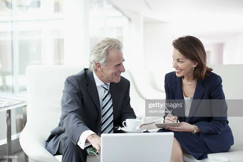 Business people working and drinking coffee : Stock Photo