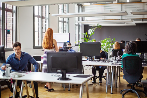 Business people working at a busy open plan office 1150572036