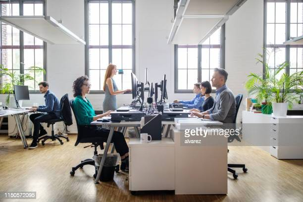 business people working at a modern office - moderno foto e immagini stock