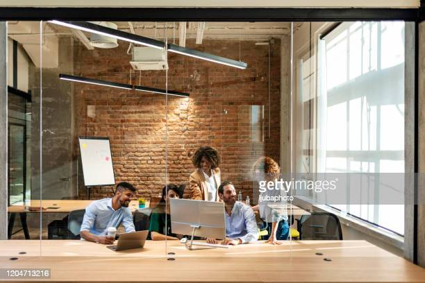 business people working at a modern office - employee engagement stock pictures, royalty-free photos & images