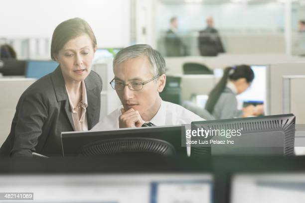 Business people working at computer in office