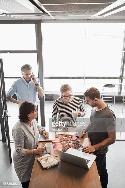 Business people working at counter in office cafe