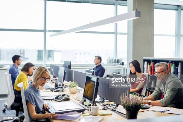 business people working at desk by windows - trabalho imagens e fotografias de stock