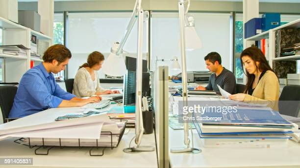 Business people working at desk in office