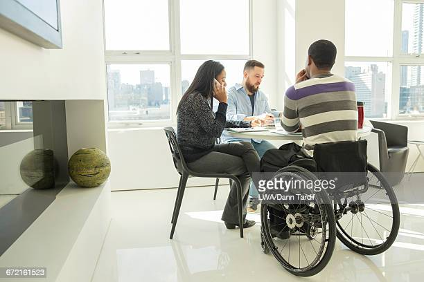 Business people working at table