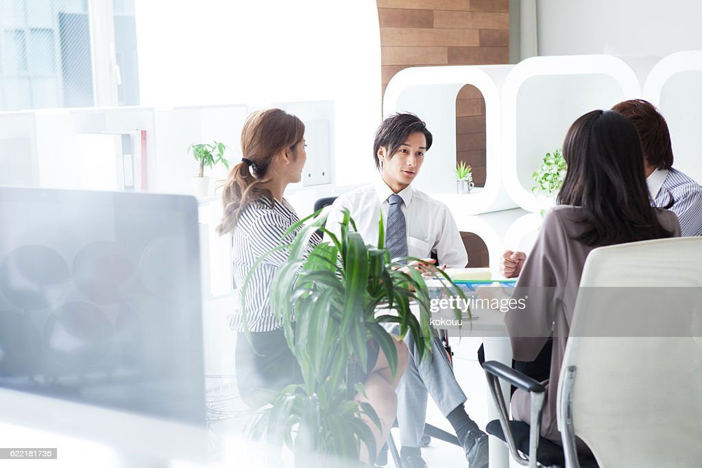 Business people working in a modern office : Stock Photo