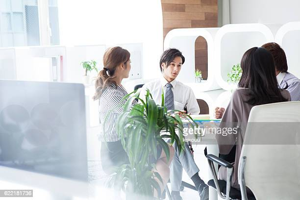 business people working in a modern office - real estate office stock photos and pictures