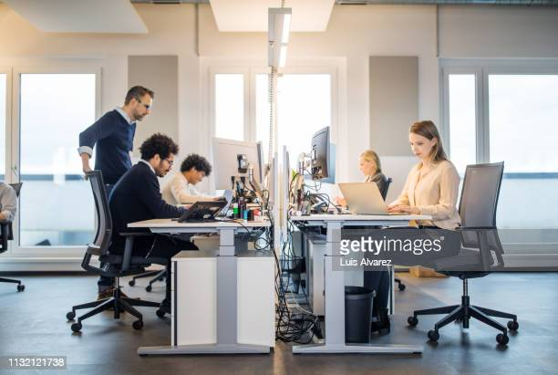 business people working in a small office - colletti bianchi foto e immagini stock