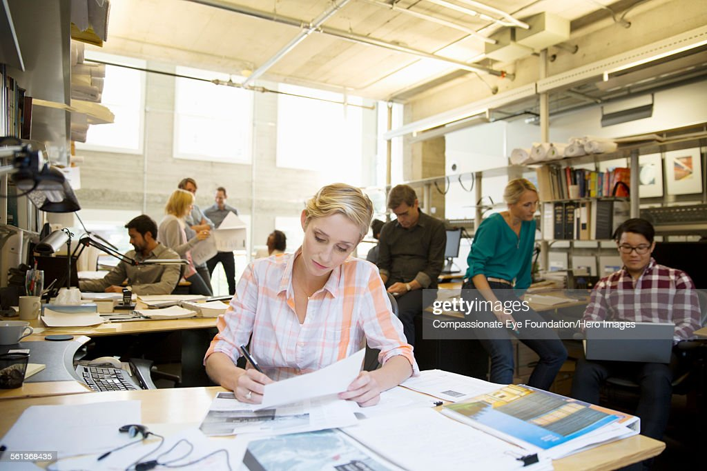 Business people working in busy office : Stock Photo