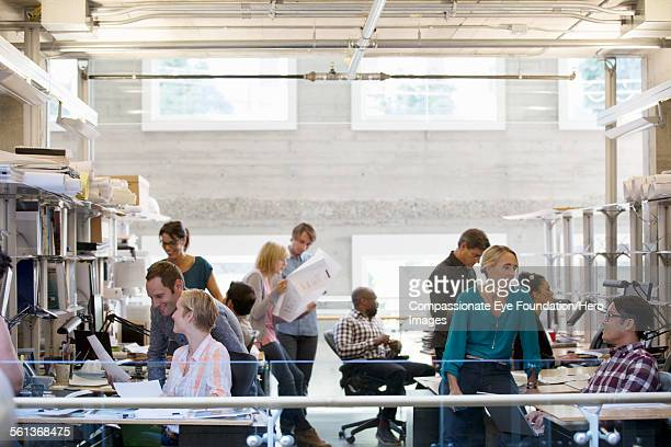 Business people working in busy office