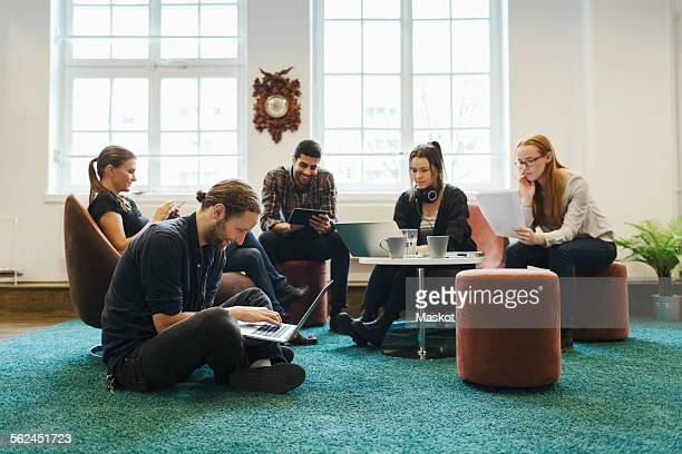 business people working in creating workspace - ottomane stockfoto's en -beelden