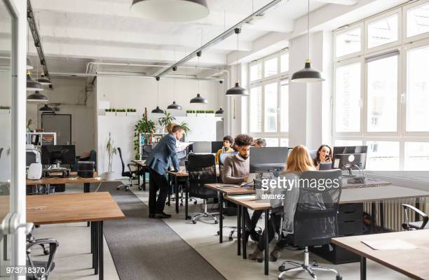 business people working in modern office space - lavoratori dipendenti foto e immagini stock