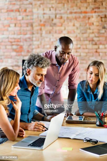 business people working in office of a start-up company, having a meeting - founder stock pictures, royalty-free photos & images