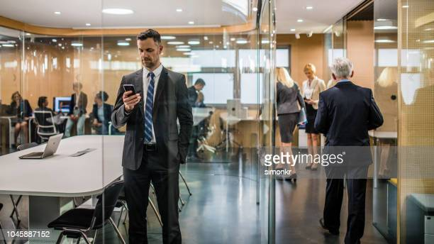 business people working in office - coat stock pictures, royalty-free photos & images