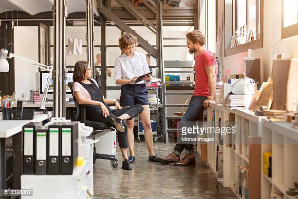business people working in office - shorts stock pictures, royalty-free photos & images